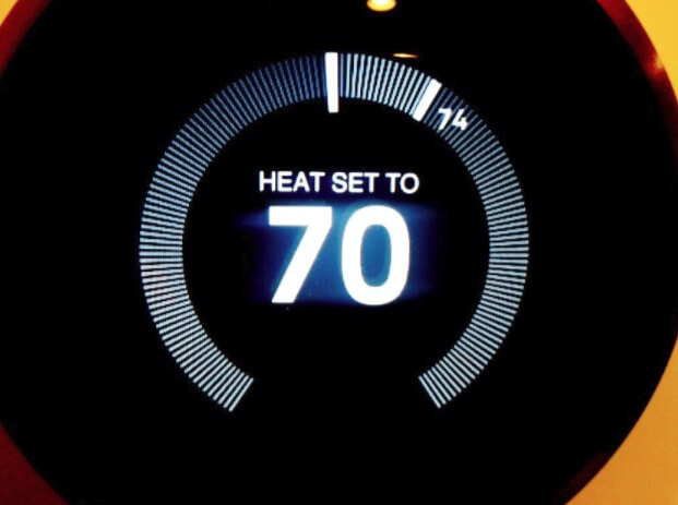 A programmable thermostat set to 70 degrees