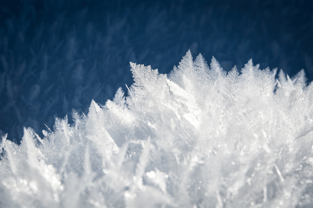 Ice and frost over a blue backdrop