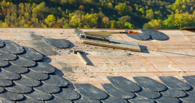 Tools sitting on a tile roof that is being installed