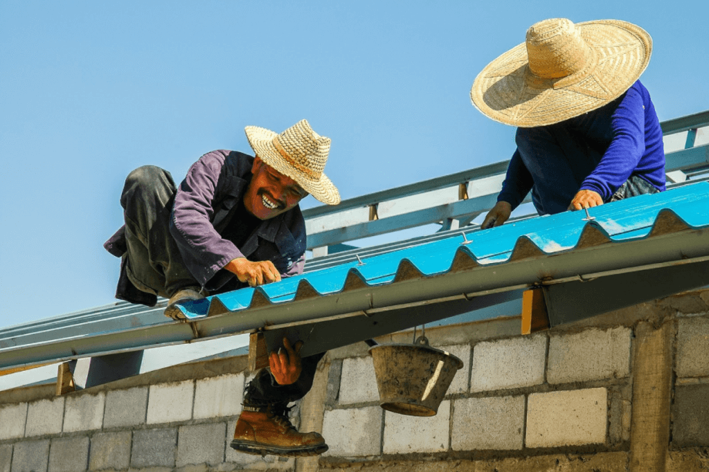 Roofers working on a home